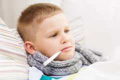 Ill boy with flu at home Royalty Free Stock Image
