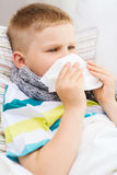 Ill boy with flu at home Royalty Free Stock Photos