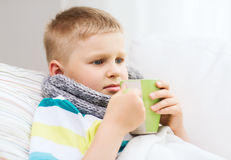 Ill boy with flu at home Stock Image