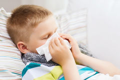 Ill boy with flu at home. Childhood, healthcare and medicine concept - ill boy with flu at home Stock Photography