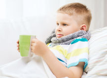 Ill boy with flu at home Royalty Free Stock Photo