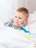 Ill boy with flu at home Royalty Free Stock Images