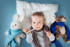 Ill boy lying in bed Royalty Free Stock Image