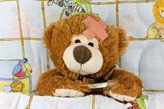 Ill brown Teddy-bear Stock Images