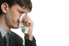 Ill businessman. Ill young man with sad eyes and kleenex on his nose Stock Photos