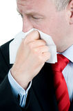 Ill businessman with tissue Stock Images