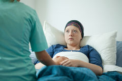 Ill with cancer girl. Talking with doctor stock photos