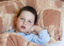 Ill child in bed stock image