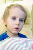 Ill child in bed Stock Photos