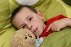 Ill child with fever Royalty Free Stock Photo