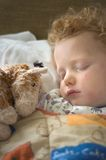 Ill Child Sleeping Stock Images