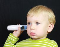 Ill child and thermometer royalty free stock photography