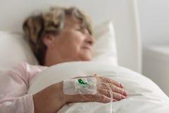 Ill female retiree Stock Image