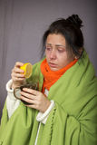 Ill flu girl presses a lemon in your tea stock photography