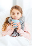 Ill girl child with cup of hot tea. Healthcare and medicine concept - ill girl child with cup of hot tea Royalty Free Stock Photos
