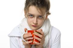 Ill girl with cup Royalty Free Stock Images