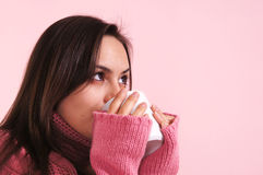 Ill girl with cup Stock Images