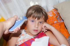 Ill girl with high temperature. Ill girl in bed with high temperature Royalty Free Stock Images