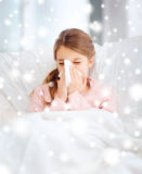 Ill girl with paper tissue Royalty Free Stock Images