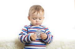 An ill girl with pills in her hands. The boy holds a tablet in his hands, picks up Stock Photo