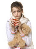 Ill girl with red cup and bear. Isolated on white background Stock Images