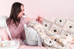 Ill girl at sofa Royalty Free Stock Images