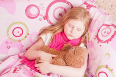 Ill girl with toy Royalty Free Stock Photos