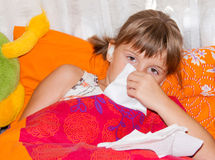 Ill girl. Unhealthy child in bed Royalty Free Stock Image