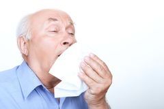 Ill grandfather holding handkerchief Stock Images