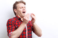 Ill guy holding handkerchief Stock Photos