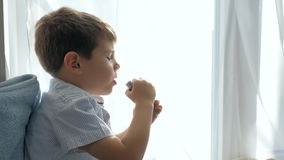 Ill kid breathes through tube from an Nebulizers for treatment asthma. At home stock video