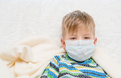 Ill little boy in medicine health-care mask Royalty Free Stock Photo
