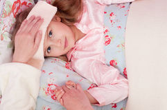Ill little girl Stock Photography