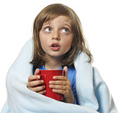 Ill little girl with cup of hot tea Royalty Free Stock Photos