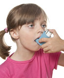 Ill little girl with inhaler. Little girl using inhaler - respiratory problems isolated on white background Royalty Free Stock Photography