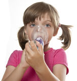 Ill little girl using inhaler. Respiratory problems white background Stock Photos