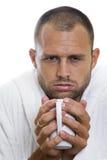 Ill Man. Man feeling ill with a mug of hot dreink stock photo