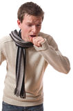 Ill man. Young ill man with scarf coughing isolated over white background royalty free stock photos