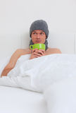 Ill man bed Stock Images