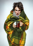 Ill Man covered with plaid blanket with hot tea Royalty Free Stock Photos
