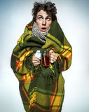 Ill Man covered with plaid blanket with hot tea. / sick man suffering cold and winter flu virus. Medication or drugs abuse, healthcare concept Stock Photos