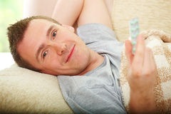 Ill man with drugs Royalty Free Stock Photography