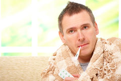 Ill man with a fever Stock Photo