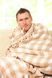 Ill man with a fever Royalty Free Stock Photos