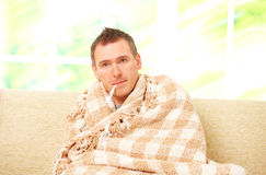 Ill man with a fever Royalty Free Stock Photography