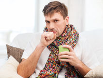 Ill man with flu at home. Healthcare and medicine concept - ill man with flu at home Stock Photos