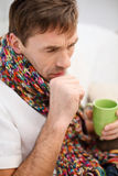 Ill man with flu at home. Healthcare and medicine concept - ill man with flu at home Royalty Free Stock Images