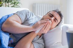 Ill man portrait suffering fever and cold royalty free stock photos