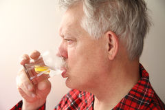 Ill man with soothing drink Stock Photos