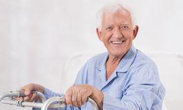 Ill man with walking frame Royalty Free Stock Photo